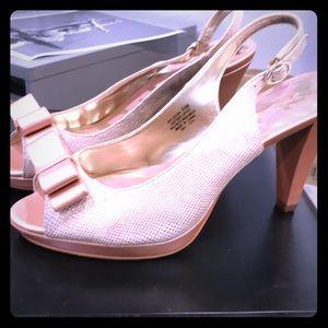 Pink bow tie peep toe heels
